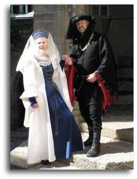 wealthy medieval noble and wife ready for medieval banquet