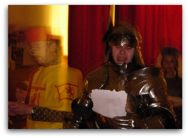 knight in armour greets lord and lady at  medieval banquet