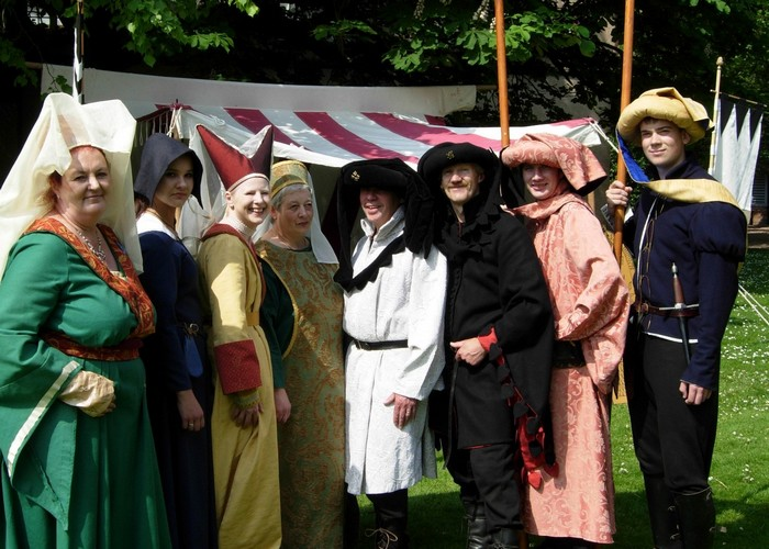 medieval costumes worn by feast guests