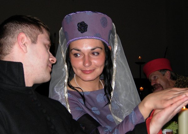medieval lady with escort at banquet